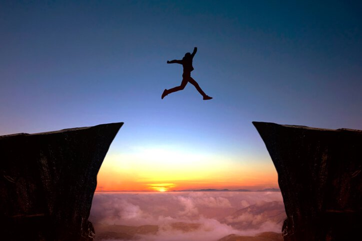 person leaping over canyon - best rated joint replacement surgeons portsmouth nh