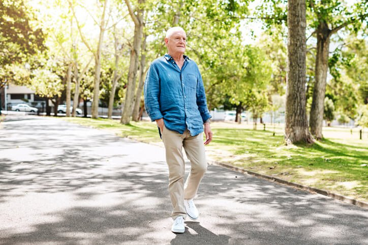 elder man walking - knee and hip replacement surgery restrictions portsmouth nh